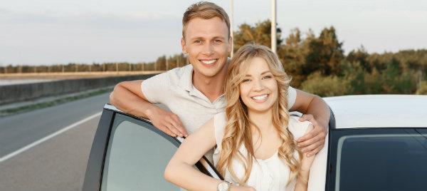 cute couple beside their white car