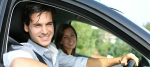 cheerful couple ready to drive their car hire
