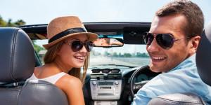 A happy couple enjoying the roadtrip