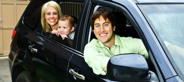happy family posing inside their brand new car