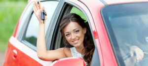 woman holding the key of her car hire in parramatta