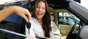 woman receiving her car rental key in palm cove