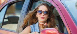 happy pretty brunette woman inside her car hire in rocklea
