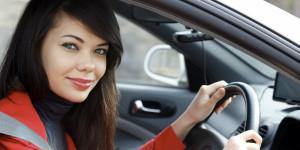 pretty woman posing inside her car hire in box hill