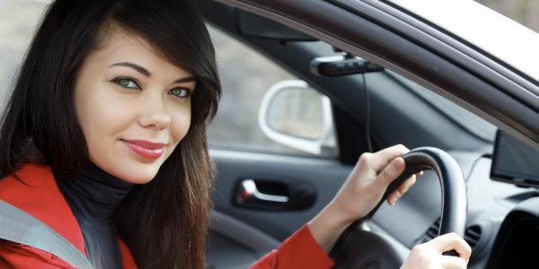 pretty woman posing inside her new car